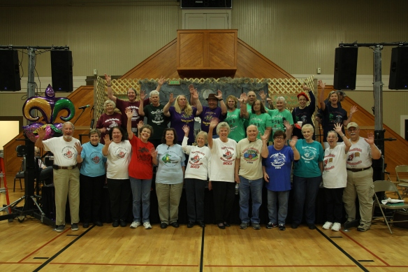 Lagniappe Members with T-shirts waving - IMG_0441